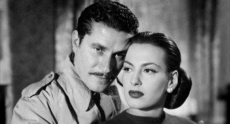 Amedeo Nazzari con Yvonne Sanson in una scena del film Catene