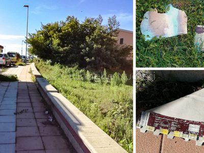 Via Pertini e alcuni cartoni di uova abbandonati per strada (© Cronache Nuoresi)